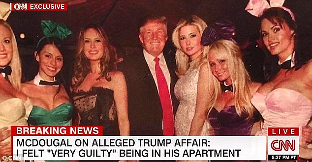 McDougal is seen far right in this photo with Melania Trump (third from left), Donald Trump (center), and Ivanka Trump (third from right)