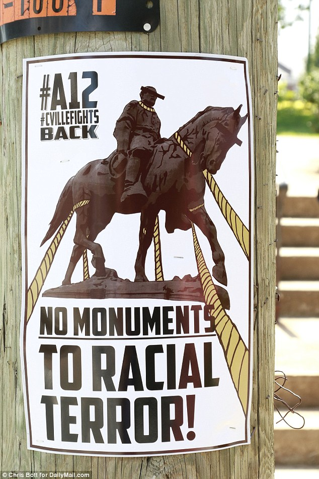 A sign is seen close to the26-ft. high bronze statue of Robert E. Lee ahead of theanniversary of last year's deadly Unite the Right rally