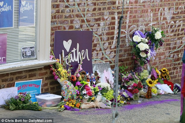 The spot is covered with flowers and anti-hate chalk messages as the anniversary of her death approaches